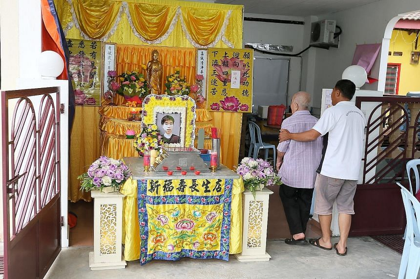 Corporal Kok Yuen Chin's wake in Melaka on Tuesday. The NSF was found unconscious in a station pump well after ragging activities.