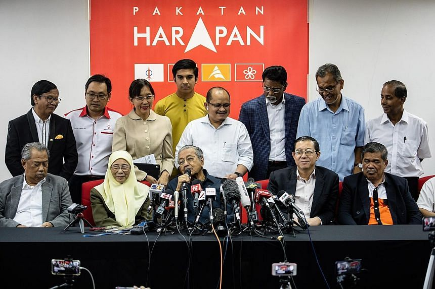 Datuk Seri Anwar Ibrahim speaking to the media at his home in Kuala Lumpur yesterday. Mr Anwar, who was pardoned on Thursday, is now part of the ruling PH's presidential council, the alliance's top decision-making body. (From left) Malaysia's Home Mi