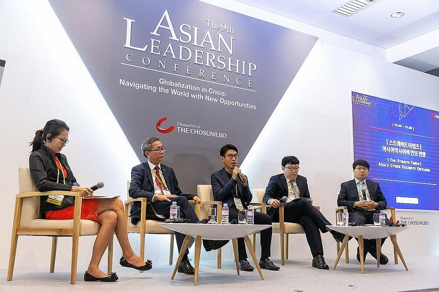 From left: ST senior technology correspondent Irene Tham moderated a panel discussion on cyber security at the Asian Leadership Conference in Seoul, which featured Mr David Koh of the Cyber Security Agency of Singapore, Mr Choi Sang Myung of Hauri, M