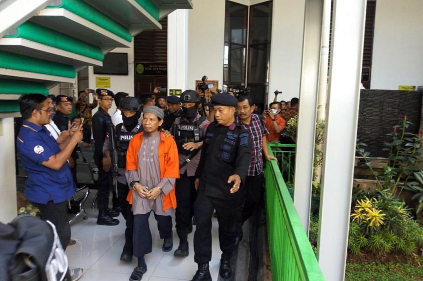 Indonesian radical cleric Aman Abdurrahman entering a court room on May 18 where prosecutors will be making their recommendation to judges on his sentence.