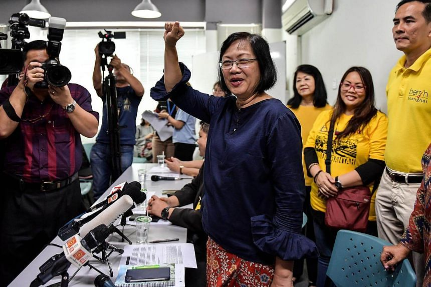 Maria Chin Abdullah (centre) gestures after a press conference in Kuala Lumpur on March 6, 2018.