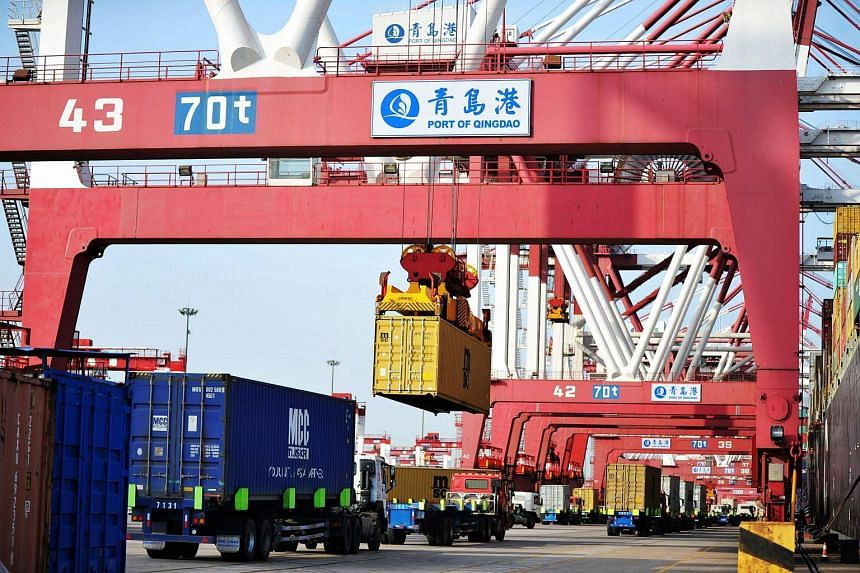 Containers are transferred at the port in Qingdao in China's eastern Shandong province, on May 8, 2018.
