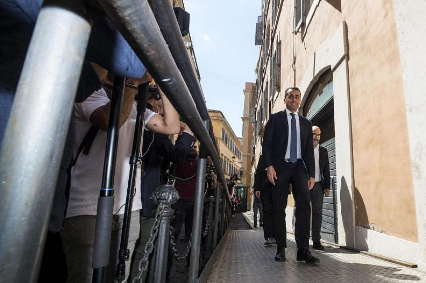 Five-Star Movement leader Luigi Di Maio (second from right) leaves the Lower House at the end of his meeting with League leader Matteo Salvini (not pictured) in Rome on May 17, 2018.