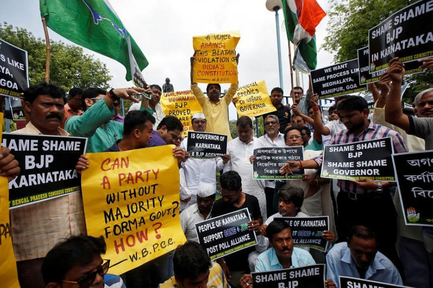 Supporters of India's main opposition Congress party protest in Kolkata on May 18, 2018, against India's ruling Bharatiya Janata Party leader B.S. Yeddyurappa's swearing-in as Chief Minister of Karnataka state.
