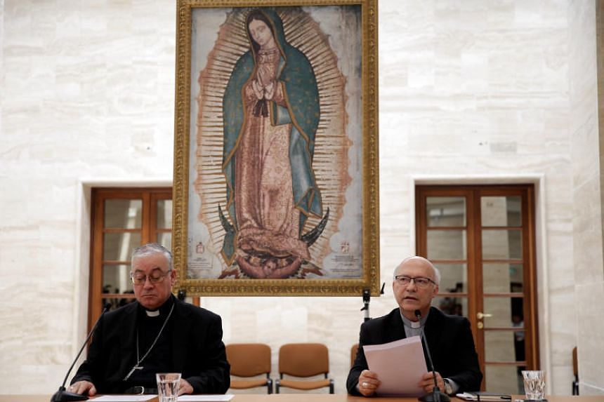 Members of Chile's bishops conference Luis Fernando Ramos Perez (right) and Juan Ignacio Gonzalez (left) give a press conference in the Vatican on May 18, 2018.