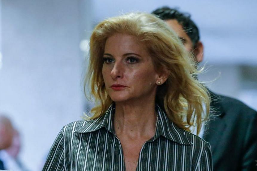 Summer Zervos, a former contestant on The Apprentice arriving with lawyer Gloria Allred at the New York County Criminal Court on Dec 5, 2017, in New York.