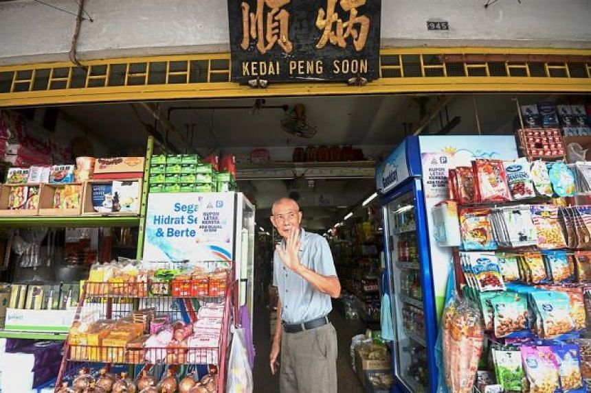 Mr Lee Peng Soon waving to reporters at his shop in Petaling Jaya. At Kedai Peng Soon, the father-and-son team is scratching their heads on how to update the prices of 1,000 products in their small grocery store.