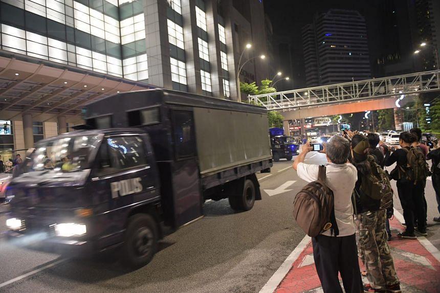 A truck leaving former PM Najib Razak's Pavilion Residences on May 18, 2018.