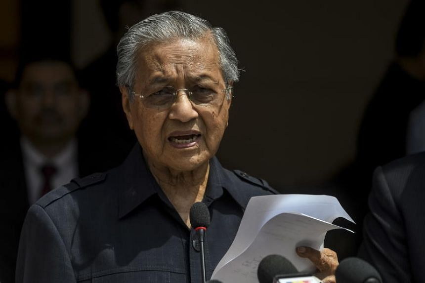"""Malaysia's Prime Minister Mahathir Mohamad said he """"would like to"""", but cannot take up the education portfolio."""