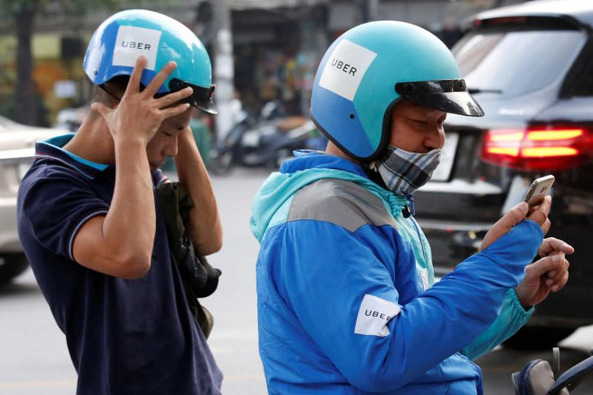 An Uber driver picks up a rider in Hanoi on Nov 28, 2017.
