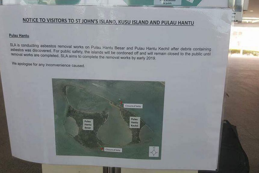 A notice on Marina South Pier indicating ongoing asbestos removal works.