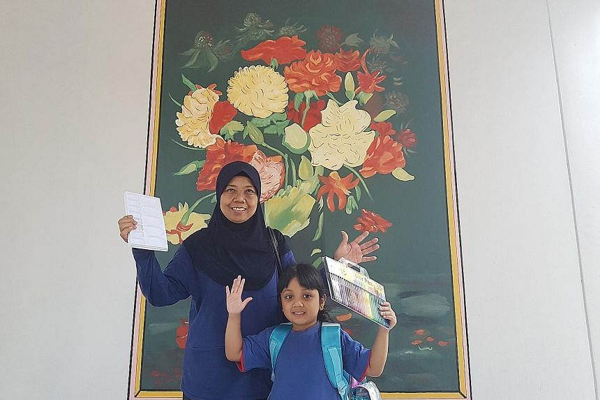 Above: Madam Hasmah Misdawi and her granddaughter Nawra Balqis with one of the Vincent van Gogh-inspired paintings at the void deck of their Teck Whye block. Left: The HDB blocks in Teck Whye with a red, blue and yellow mosaic pattern, reminiscent of