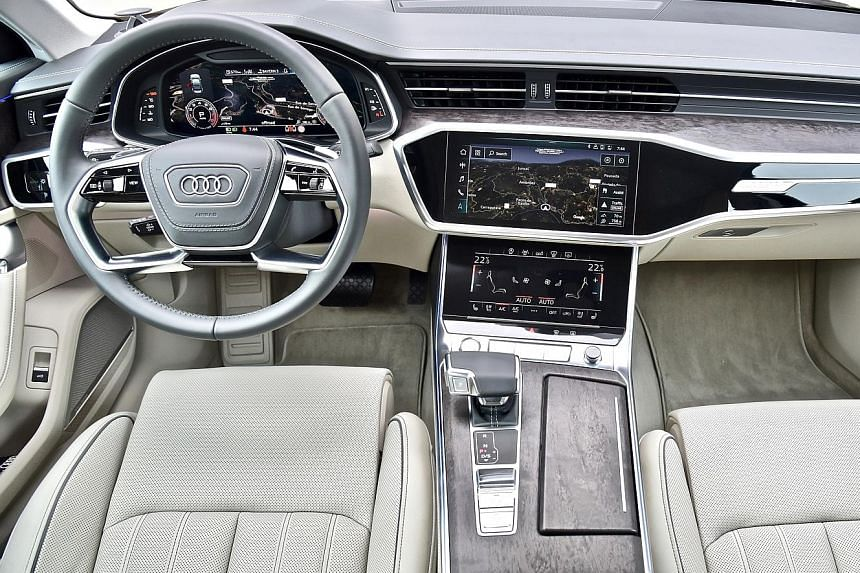 The interior of the Audi A6 sports open-pore wood inlays and aluminium trim accents as well as a highly digitalised dash and centre console.