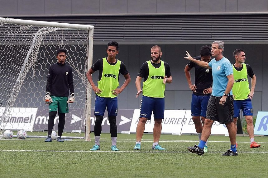 Tampines Rovers coach Jurgen Raab (in blue) giving instructions to his players during training. He knows the Stags must be at the top of their game to beat Albirex Niigata tomorrow.