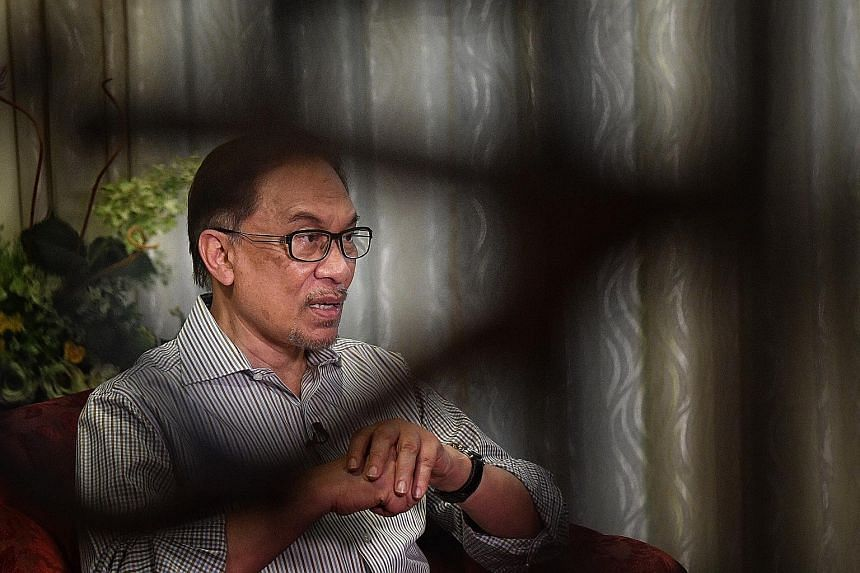 """Datuk Seri Anwar Ibrahim, speaking to The Straits Times yesterday at his home, said he had advised former prime minister Najib Razak """"as a friend"""" to """"accept the results, concede early, and move on"""", when the latter called him on election night as th"""