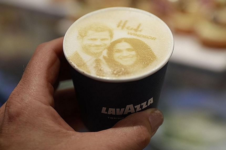 """Far left: Police officers patrolling the streets. More than 100,000 members of the public are expected to turn up. Left: Businesses continue to cash in, with novelty items such as this drink, the """"Megharryccino"""". Above: Fans with a cut-out of Queen E"""