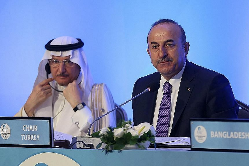 Turkish Foreign Minister Mevlut Cavusoglu (in tie) and Organisation of Islamic Cooperation secretary-general Yousef Ahmad Al-Othaimeen in Istanbul, Turkey, yesterday. Turkey has been one of the most vocal critics of the US Embassy in Israel moving to