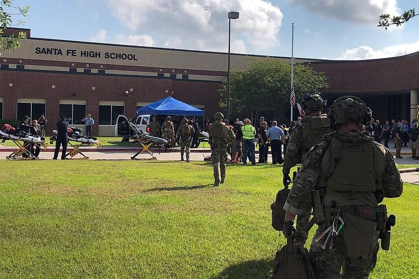 """Officers from Harris County Sheriff's Office at Santa Fe High School. The sheriff's office said its deputies were assisting with a """"multiple-casualty incident""""."""
