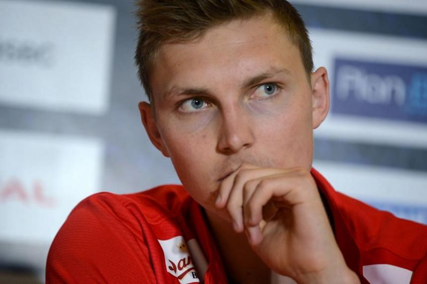 Viktor Axelsen listens during a press conference ahead of the Thomas and Uber Cups badminton tournament in Bangkok on May 19, 2018.