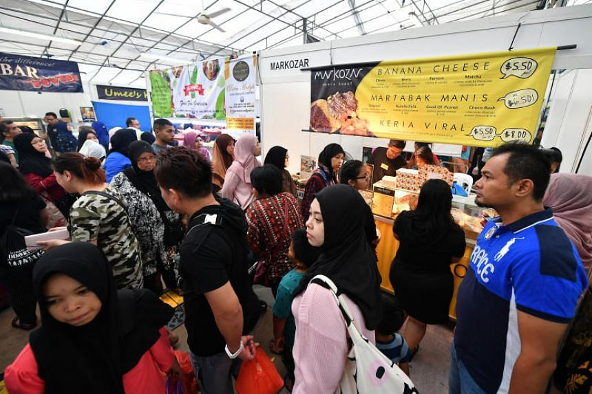 This year's Bazaar Raya Utara features a record 80 stalls, selling everything from street food to homemade Hari Raya goodies.