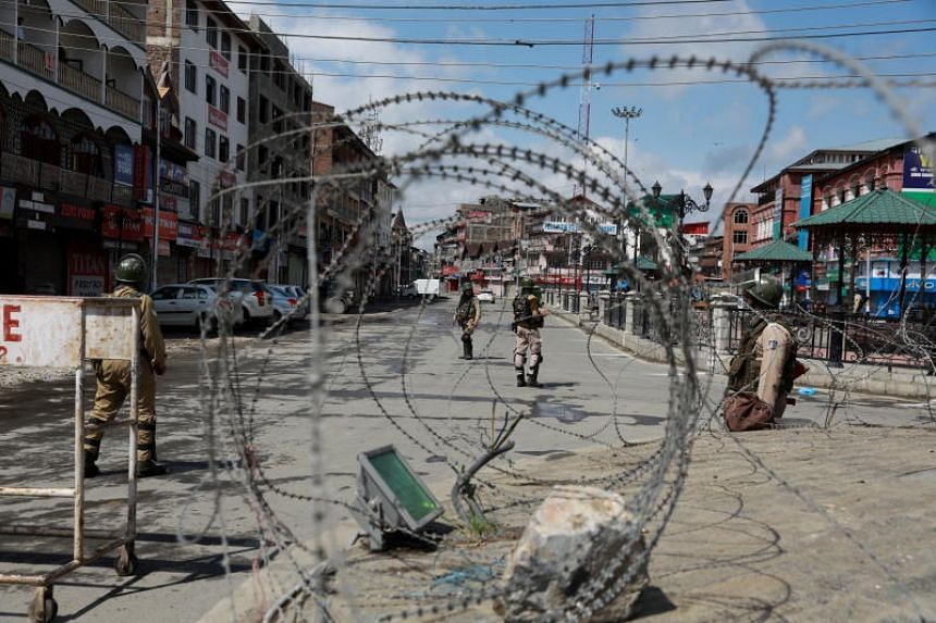 Shops shut and the main streets of the main city of Srinagar were empty except for police and paramilitary patrols.