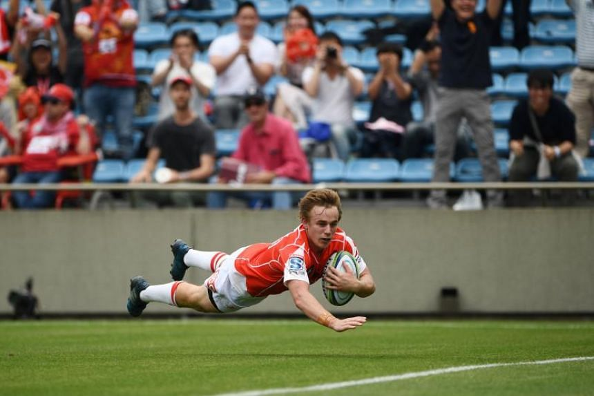 A file photo taken on May 12, 2018, shows Sunwolves' Hayden Parker scores a try during the Round 13 Super Rugby match between the Sunwolves of Japan and the Reds of Australia at Prince Chichibu Memorial Stadium in Tokyo.