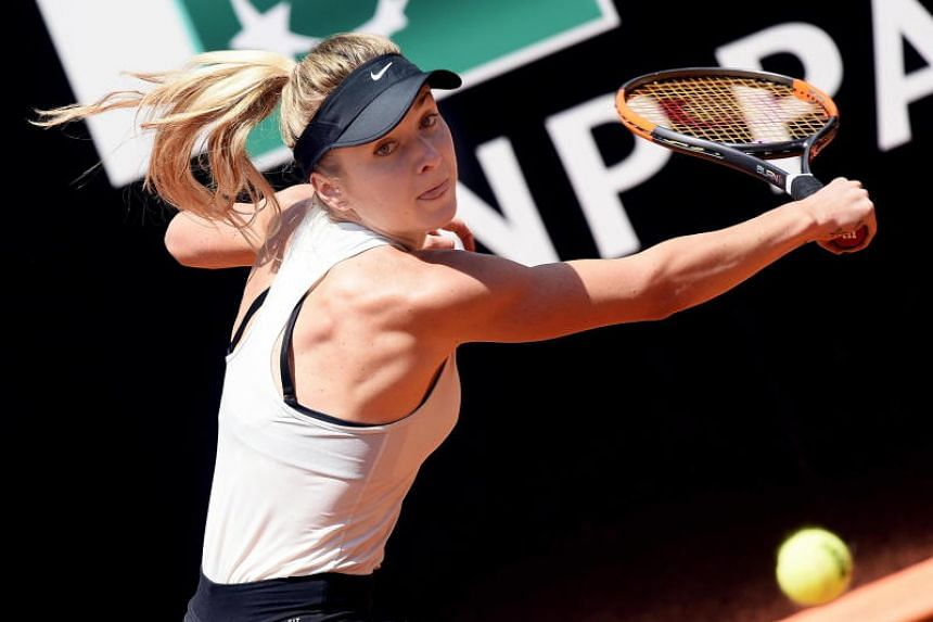 Ukraine's Elina Svitolina returns a ball in her women's singles semi-finals match against Estonia's Anett Kontaveit during the Italian Open in Rome on May 19, 2018.