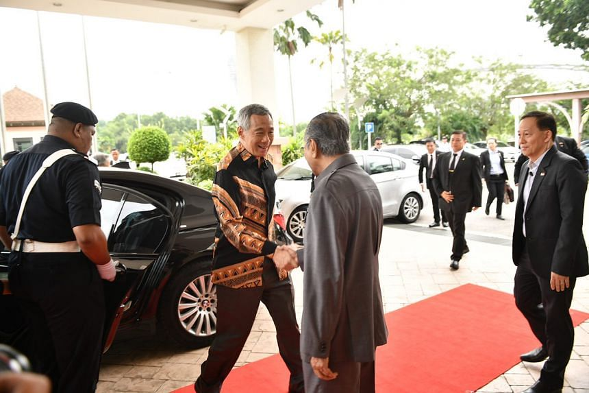 Prime Minister Lee Hsien Loong greets his Malaysian counterpart Dr Mahathir Mohamad at the Perdana Leadership Foundation, on May 19, 2018.