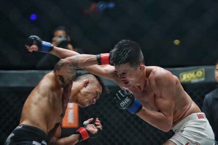 Christian Lee of Singapore (right) in action against Martin Nyugen of Australia for the Featherweight World Championship during One Championship: Unstoppable Dreams at Singapore Indoor Stadium on May 18, 2018.