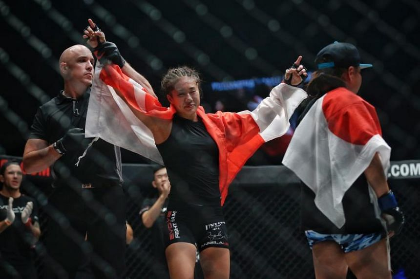 Angela Lee of Singapore being announced the winner against Mei Yamaguchi of Japan during the Women's Atomweight World Championship bout of One Championship: Unstoppable Dreams at Singapore Indoor Stadium on May 18, 2018.