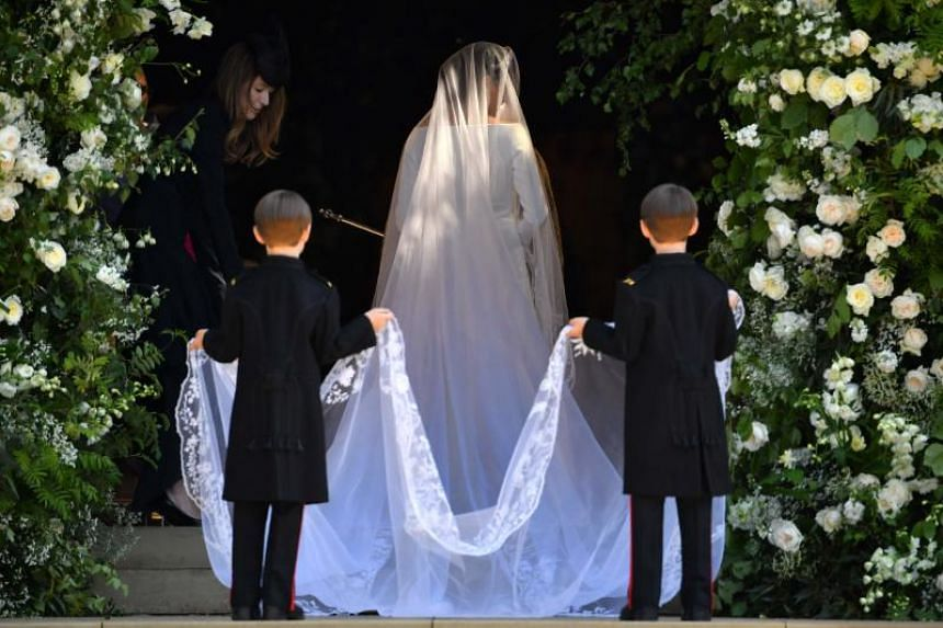 US actress Meghan Markle arrives for her wedding to Britain's Prince Harry at St George's Chapel, Windsor Castle, on May 19, 2018.