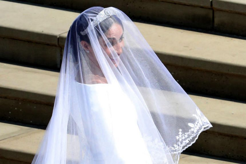 Meghan Markle arrives at St George's Chapel at Windsor Castle for her wedding to Prince Harry on May 19, 2018.