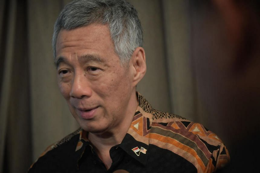 Prime Minister Lee Hsien Loong speaks to Singapore reporters after visiting Malaysia's new prime minister Mahathir Mohamad in Putrajaya on May 19, 2018.