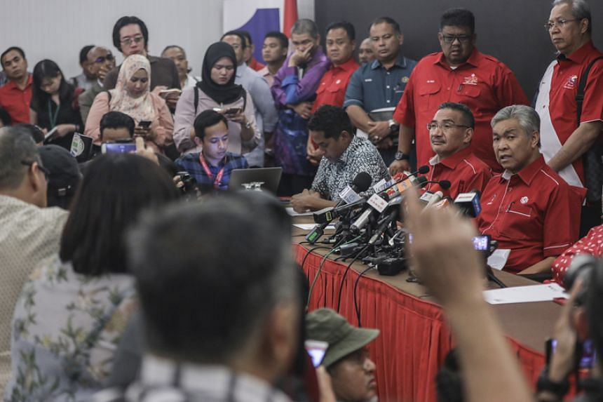 Umno's acting president Ahmad Zahid Hamidi (right) speaks during a press conference in Kuala Lumpur on May 14, 2018.
