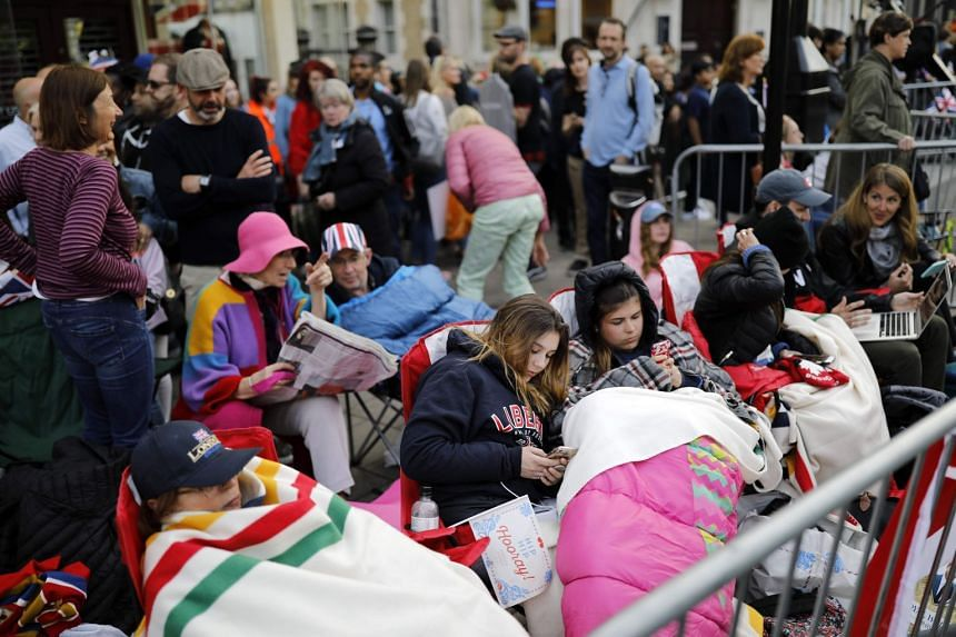 Royal well-wishers prepare to bed down for the night in Windsor on May 18, 2018, the eve of Britain's Prince Harry's royal wedding to US actress Meghan Markle.