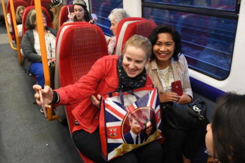Royal enthusiasts travel on the first train from Waterloo to Windsor ahead of the royal wedding ceremony of Britain's Prince Harry and Meghan Markle at St George's Chapel in Windsor Castle in Windsor, Britain, on May 19, 2018.