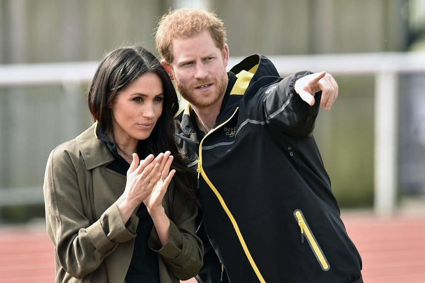 A file photo of Britain's Prince Harry and American actress Meghan Markle visiting Bath University, on April 6, 2018.