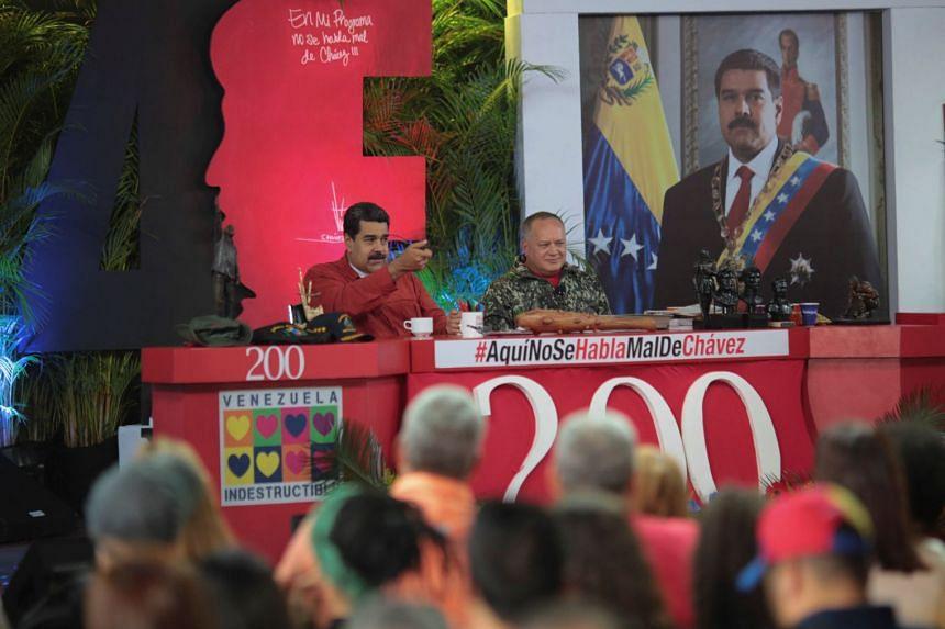 Venezuela's President Nicolas Maduro speaks during a TV show with National Constituent Assembly member Diosdado Cabello in Caracas, Venezuela, on April 11, 2018.