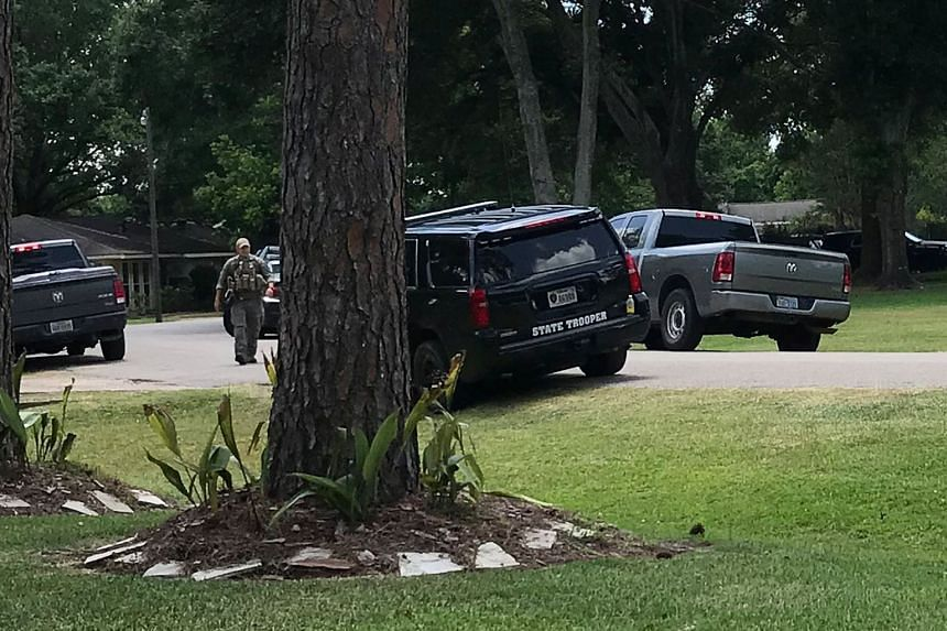 Police vehicles line the blocked-off street where the home of Dimitrios Pagourtzis, the suspect in the Santa Fe High School shooting, is located in Alvin, Texas, on May 18, 2018.