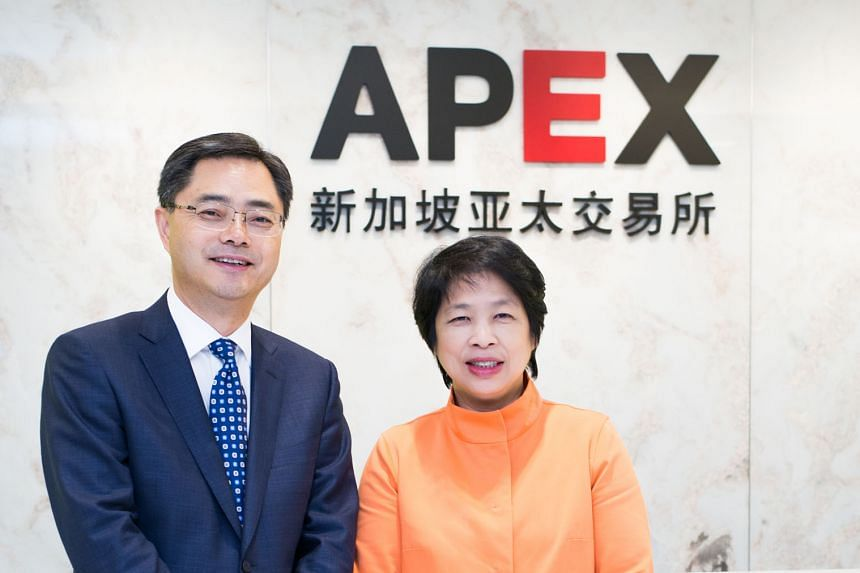 Asia Pacific Exchange founder and chief executive officer Eugene Zhu and its chairman, Mrs Lim Hwee Hua. Apex will offer palm olein futures that will be dollar-denominated and physically delivered.
