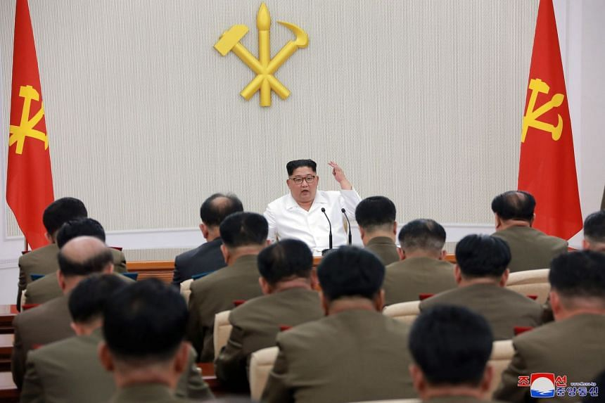 North Korean leader Kim Jong Un chairing the first Enlarged Meeting of the 7th Central Military Commission of the Workers' Party of Korea in Pyongyang yesterday, in a photo released by the Korean Central News Agency. President Donald Trump said a sum