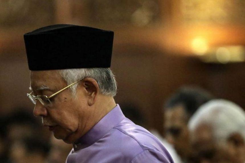 Former Malaysia prime minister Najib Razak reacts during Friday prayers in Kuala Lumpur, on May 18, 2018.