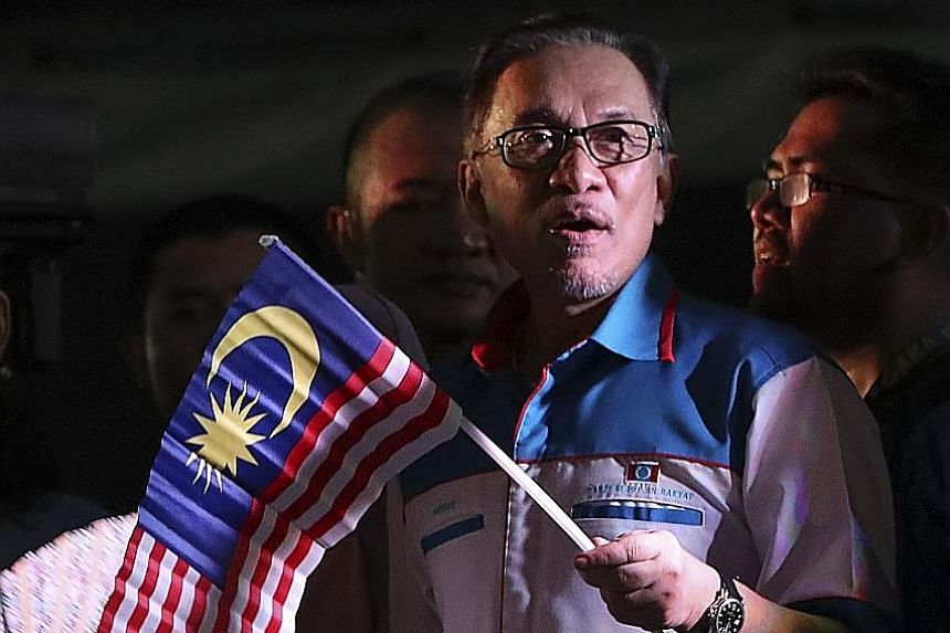 Mr Anwar Ibrahim at a celebration following his release from prison in Petaling Jaya late on Wednesday. He has gone to great lengths in recent days to lend his support to the new Mahathir-led government, insisting that he is in no hurry to take over.