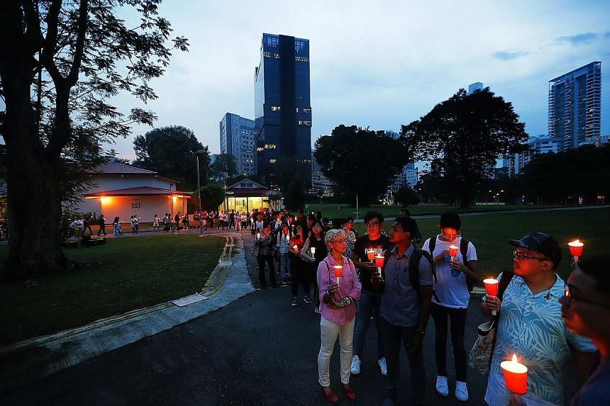 About 100 people, including those with HIV, their friends, families and healthcare workers, gathered to light candles and silently walk the grounds of the Communicable Diseases Centre for the last time yesterday.