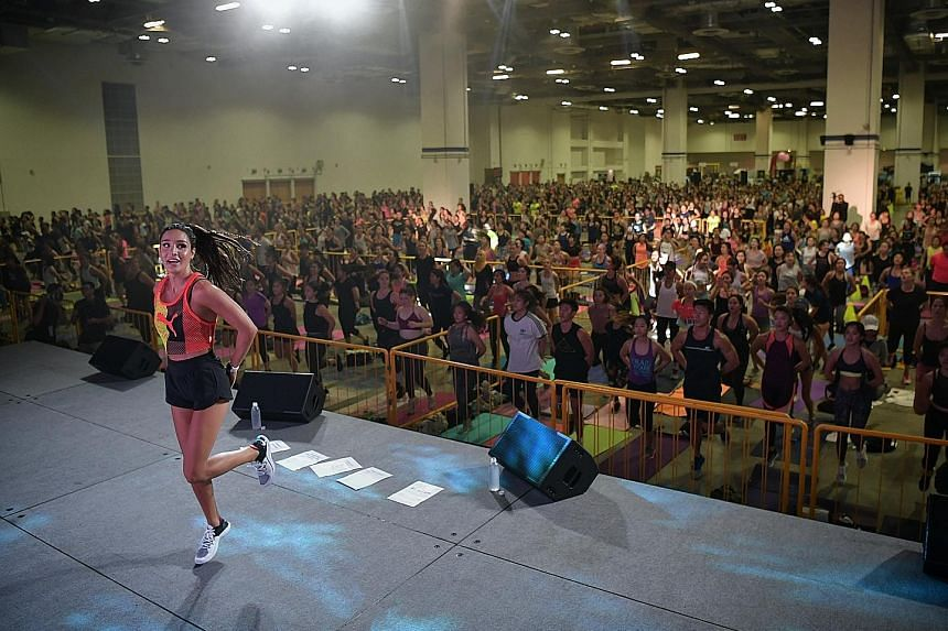 Global fitness influencer Kayla Itsines at her BBG boot camp in Marina Bay Sands Expo and Convention Centre yesterday. She is looking to expand her US$63 million (S$85 million) empire in the region.