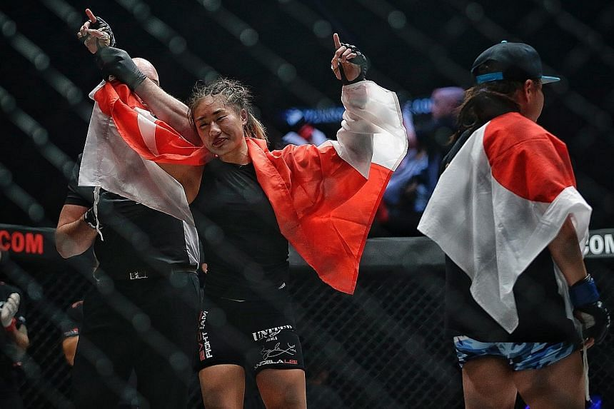 Angela Lee being announced the winner after a hard-fought win over Japan's Mei Yamaguchi during the One Championship atomweight title fight at the Singapore Indoor Stadium on Friday. Lee won by unanimous decision to retain her belt.