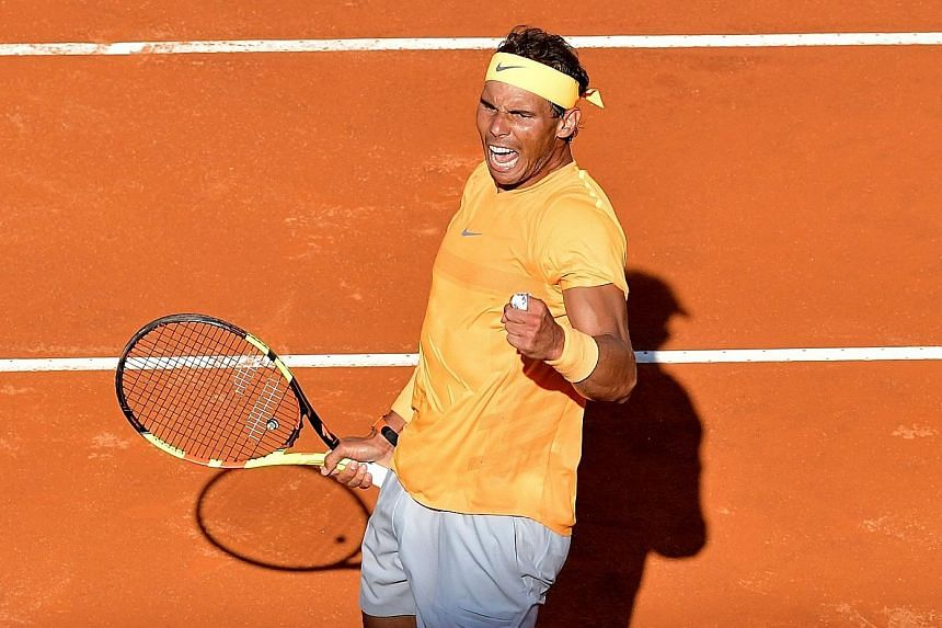 Rafael Nadal celebrating after winning his semi-final against Novak Djokovic at Rome's Italian Open. Nadal is in today's final for a record 10th time.