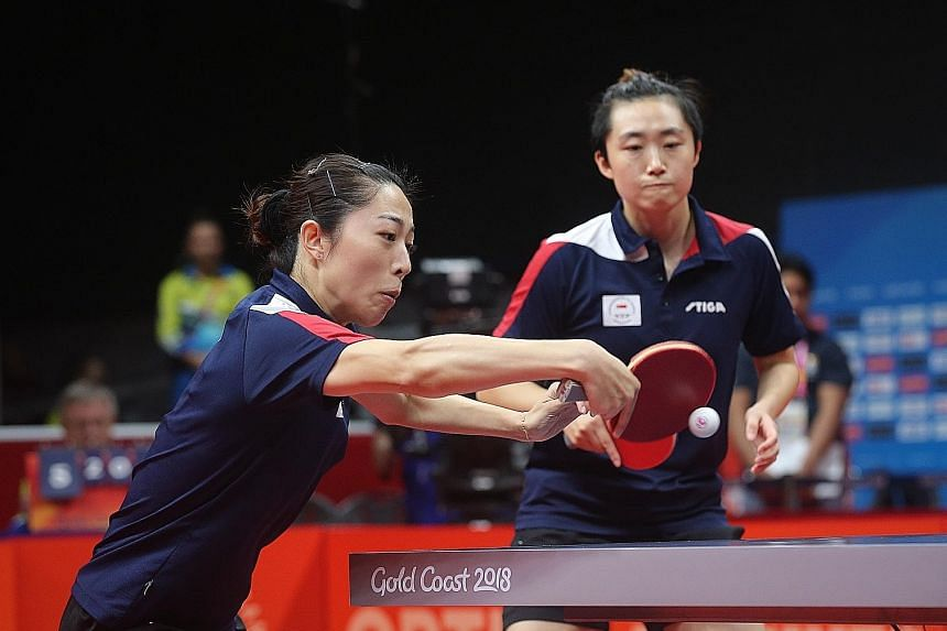Yu Mengyu (left) and Feng Tianwei on the way to winning the Commonwealth Games women's doubles gold. In Feng and Yu, Singapore have two of the highest-ranked women in South-east Asia. Singapore won five golds at last year's SEA Games in Kuala Lumpur.
