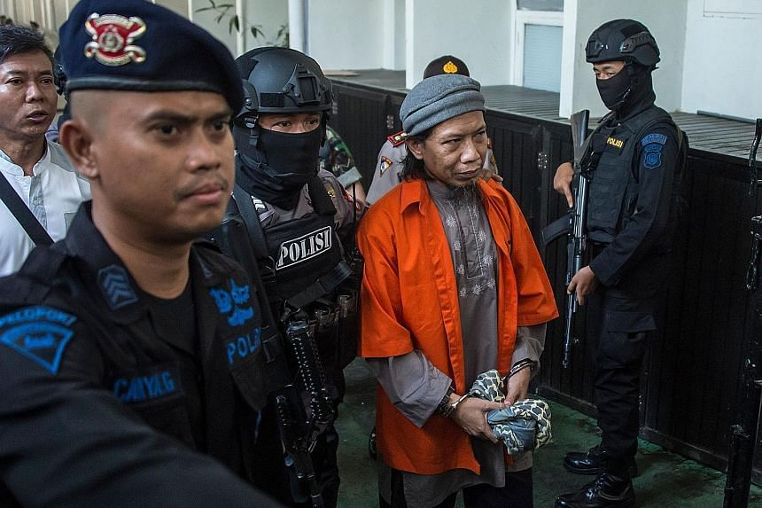 Heavily armed police officers escorting Aman Abdurrahman, who founded the JAD terror network in 2014, to a court hearing in Jakarta last Friday. Aman is said to be Indonesia's most dangerous terrorist ideologue. Zainal Anshori prior to his trial in J