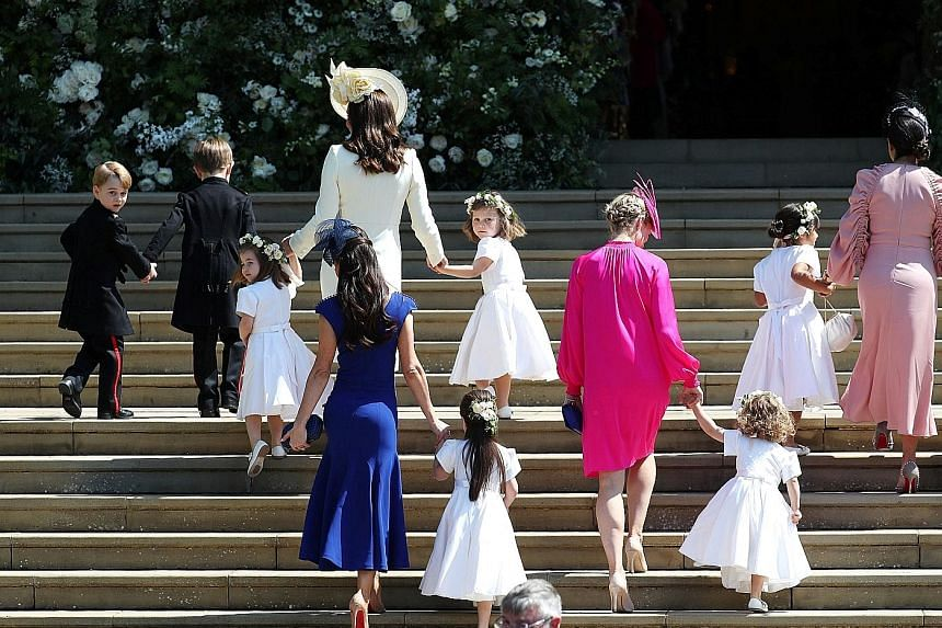 Ms Doria Ragland, Prince Charles and his wife Camilla, Prince William and his wife Catherine and their children, Prince George and Princess Charlotte, leaving the chapel after the wedding. The Duchess of Cambridge (in white) and other guests arriving